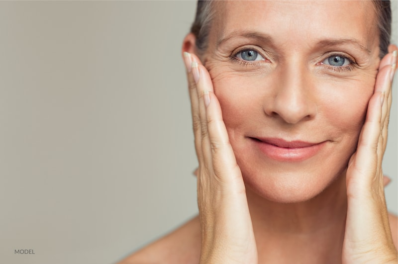 middle age woman following a cosmetic face procedure.